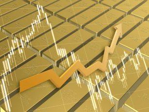 金の延べ棒と株価チャート