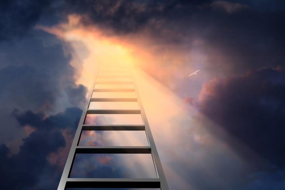 天の光に向かって伸びるはしご