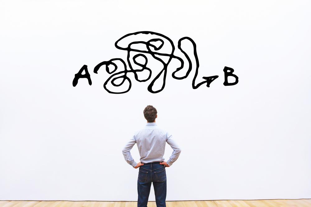 AからBまでの過程を考える男性